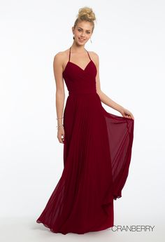 Stand by her side in stunning fashion in this gorgeous bridesmaid dress! With its v-neckline, fitted bodice, pleated skirt, and lace-up back, this evening gown is a classic choice for wedding day. Pair it with rhinestone heels, a rhinestone ring, and a satin clutch. #camillelavie