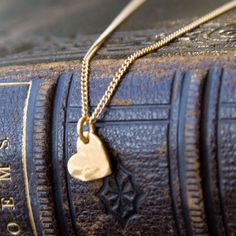 mini heart gold hammered necklace