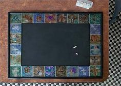 If an Elephant Can Paint... paint-your-own pottery studio Embossed metal squares; chalk board