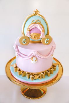 Gold and pink carriage cake from Pretty Princess Cinderella Birthday Party at…