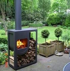 contemporary central wood-burning stove for outdoor SPOT by Jos Muller Harrie Leenders