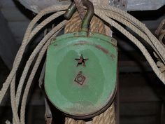 Old Rusty Green Pulley...with a...star.