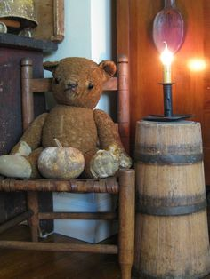 old bear in a primitive setting that looks like my decorating style