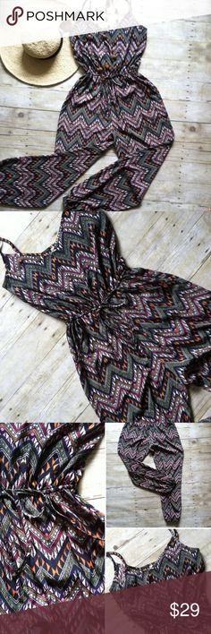 """Geometric printed boho jumpsuit Adjustable spaghetti straps. Vneck front with elastic cinch back band, waist and leg openings. Draw string to accentuate waistline. Such a fun summer piece and easy to dress up or down! In like new condition. 100% polyester. 59""""L. 17"""" bust. Size Medium. Liberty Love Pants Jumpsuits & Rompers"""