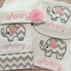 This is a wonderful gift set for any newborn or bundle of joy on the way.  White cotton bodysuit personalized with appliquéd love elephant. This set is sure to please any parent. Perfect gift for shower, baby arrival or take home hospital set. Keep it classy with trendy Love Set. Blanket measures approx. 36x26 and is 100% cotton. The beautiful Shabby Chic flower on beanie is supplied by www.BandsforBabes.Etsy.com. Bodysuit sizes available in both short sleeve (S/S) or long sleeve (L/S)  1)…