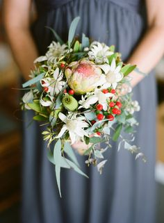 Petite style native design featuring smoky Joe Protea, flannel flower, berries, leukadendron and vine.