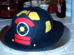 """Step-by-step Instructions on making a 3-D Fireman's Helmet Cake This cake was made as a """"his"""" cake for a &..."""