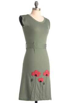 Your favorite bloom has always been poppies, and when you don this sage-green dress, you're inspired to plant an entire field of them! Featuring appliques of bright red poppies and a self-tie waist, this 100% organic cotton dress will grace your figure in floral finery. Paired with woven wedge sandals, nature-inspired jewelry, and a straw tote in which to stash your gardening supplies, this A-line dress will garner a garden of compliments.