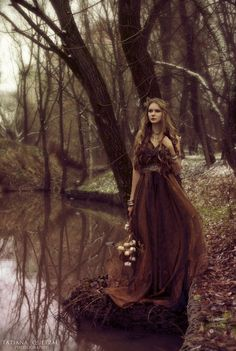 She walked the borders of the river, feeling as dreary and mysterious as the woods around her. But it was what she saw before her that changed everything