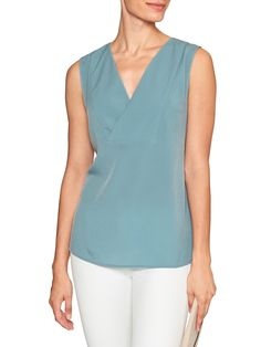 bd119978cad Super cute top from Banana Republic. The top is semi fitted and tunic  length.