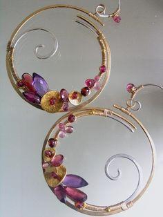 Twilight Waves...Magenta Rhodolite Amethyst Pink Sapphire laden Mixed Metal Scroll Hoop Earrings. , via Etsy.