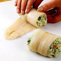 Broccoli and cheese Stuffed tilapia 4-ouncefresh or frozen skinless sole, flounder, or other fish fillets, about 1/4 inch thick 1 cupfrozen cut broccoli, thawed 1 beaten egg 1 8-ounce containersoft-style cream cheese with chives and onion 1/4 cupgrated Parmesan cheese 3/4 cupherb-seasoned stuffing mix 2 tablespoonsmilk 2 tablespoonsdry white wine
