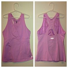 VSX work out top Adorable pink color. Has slots to add pads, doesn't come with pads. It's been tried on but never worn!! Thick material top, amazing support for any type of workout. (: use offer button if interested or bundle feature. No holds and no trades. Victoria's Secret Tops Tank Tops