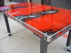 Recycled hood of a car with all its imperfections turned into a gorgeous one of a kind dining table!