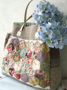 Grandmother's garden patchwork bag by STORY QUILT, via Flickr.  Not a pattern--but inspiration