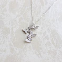 Handmade itemMaterial: Copper, platinum plating, zirconButterfly Size-0.55 inches(14*11mm)Necklace Length-15.7 inches(40cm)Allow 5 days for production