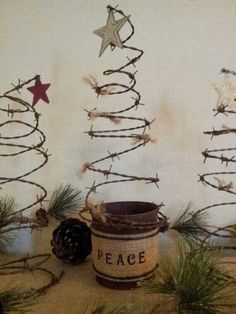 .Old bed spring with tin can wrapped in burlap to make an adorable little Christmas tree: