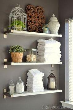Installing IKEA EKBY shelves in the bathroom of Frugal Homemaker blog.                                                                                                                                                                                 More