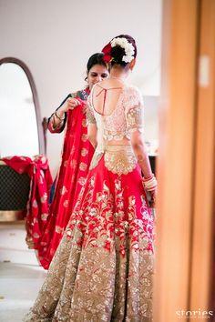 #IndianWedding Bridal Wear - Red Bridal #Lehenga w/ Lace Blouse | #WedMeGood | Anamika Khanna White, Red and Gold Lehenga with Lace Patch Work. via @topupyourtrip