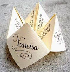 Custom designed cootie catcher for tables at reception -- fun way to learn more about bride and groom wedding decorations cheap indoor Save Your Budget with Fun and Quirky Wedding Party Games Wedding Table Games, Wedding Games For Guests, Wedding Decorations, Wedding Trivia, Wedding Venues, Wedding Placecard Ideas, Wedding Ceremony, Wedding Programs, Wedding Tables