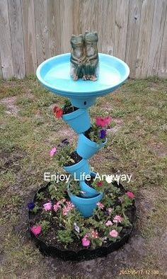 Crooked terra cotta pot planter and birdbath