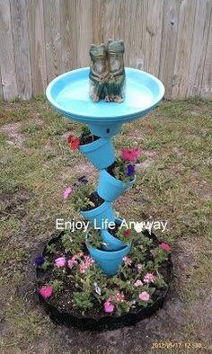 Crooked terra cotta pot planter and birdbath