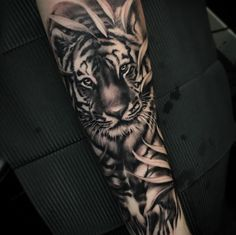 Dynamic tiger tattoo by Kimmo Angervaniva