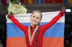 Russia's Julia Lipnitskaia celebrates her gold medal following the women's free skating at the European Figure Skating Championships in Budapest, Hungary, Friday, Jan. 17, 2014. (AP Photo/Darko Bandic)