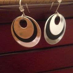 Hypoallergenic Earrings Black and silver, round, layered, hypoallergenic earrings. Not heavy. Very shiny. The silver parts really catch the light! Open to offers and happy to bundle. Boutique Jewelry Earrings