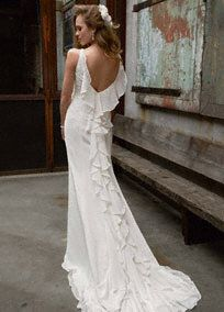 Talk about trend setting, this soft chiffon v-neck wedding dress has all the unique details for any bride wanting to celebrate her style on her walk down the aisle.   This gown is perfect for any girl who wants to make a memorable statement.  Soft gown offers exquisite lace applique details and a gorgeous ruffled back for a textured and dimensional look.  Sweep Train.