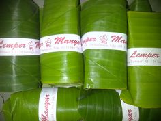 """Lemper Manyar"" - Lemper is an Indonesian dish made of glutinous rice filled with chicken, fish or abon (meat floss). The meat filling is rolled inside the rice, this is in turn rolled and wrapped inside a banana leaf, oil paper, plastic sheet or tinfoil to make a packet ready for serving. Lemper are most often seen as snacks, but may sometimes be served as appetizers as well. #wikipedia"