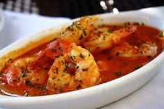 This is Gambas A Pil-Pil from Azucar!, which is jumbo shrimp sautéed in spices with a creamy garlic butter sauce. It is spicy!