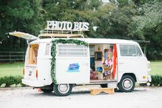 Unique wedding photo booth idea - a photo booth bus! vintage VW bus filled with…