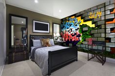 Can you believe that this graffiti wall is actually wallpaper? Bachelor pad goals!