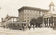 The Square in Chambersburg looking north. Trolley car mostly blocking view of fountain. Courthouse on right.
