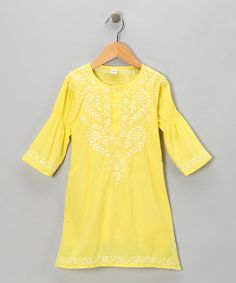 This darling dress showcases a roomy tunic-inspired silhouette, French seams, a comfy cotton feel and hand-embroidered design. Charming and worldly, it adds boho-chic flavor to any girl's closet.100% cottonHand wash; hang dryMade in India