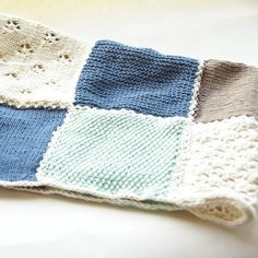 I designed and hand knitted this baby blanket in patches of different patterns. I then crocheted them together and added a small crochet border as