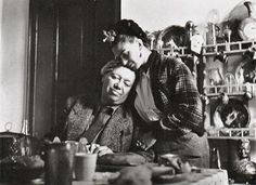 "Love fruitful and destructive?: Frida and Diego at lunch in Coyoacan (Frida's house), Fall 1941. Emmy Lou Packard (1914-1998), photographer.""This is an unposed photograph. Several times during the long mid-day meal, Frida, because her spine hurt, would get up and walk a little. Often she stopped to embrace Diego's head, which pleased him. I just said (because I had my camera shooting everything that day), ""Please just stay exactly like you are for a minute so I can photograph you"". They did."