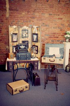 love this guest table with sewing table, spindle legged table, suitcases and antique typewriter