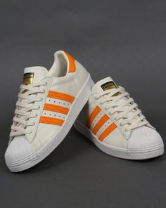 outlet store sale 59aed d1a93 Image result for orange adidas with white stripes