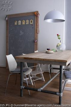 i like the giant chalk board idea for the family eating area - so many possibilities and functions!!!