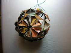 Paper ball ornaments- I love the idea of making ornaments out of old christmas cards.