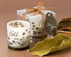 """These """"Fall in Love"""" Tea Light Candle Wedding Favors will bring warmth to autumn events and make an exquisite addition to any occasion! As elegant as it is budget-friendly, these wedding candles will have your guests wanting more than one. Each frosted white votive features elegant chocolate """"Fall in Love"""" Script and a leafy theme.  Sold as a set of 4 with tealight candles included.Each candle is individually packaged in its own clear display box and neatly finished with sheer brown organza r..."""