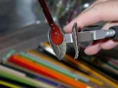 """Lampwork off mandrel leaves tutorial- Step 4: Hold the leaf mashers so the mashing face is vertical, and """"droop"""" the gather into the masher Step 5: Mash"""