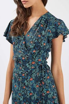 It's all about the vintage inspired florals of this cute ditsy mini dress. Featuring wrap over details and slightly frilled sleeves for a feminine touch. #Topshop