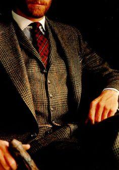 Tweed and red tartan tie.