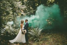 A cloud of jade green lingers in the background, adding a bit of magic to an enchanting forest setting.