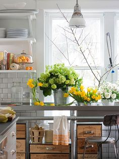 I love a classic white and steel kitchen with color added through plants, food, and flowers.  That way you don't risk being too trendy and hating the colors you chose for the backsplash, etc. it a few years.