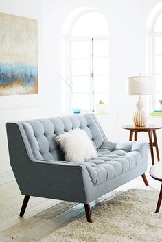 Oversized furniture can quickly make a small space feel cramped. Scale it down with sleek pieces, like Pier 1's Cece Loveseat. Built atop a hardwood frame, Cece makes mid-century design modern again. Our retro-inspired loveseat features flared arms, tapered legs and performance fabric upholstery button-tufted by hand.