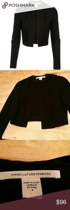 Diane Von Furstenberg Jacketeau NWOT size s Black collar less cropped jacket with an open front. NWOT. Measures 18 inches from shoulder to front hem, sleeve measures 24 inches. Diane von Furstenberg Jackets & Coats Blazers